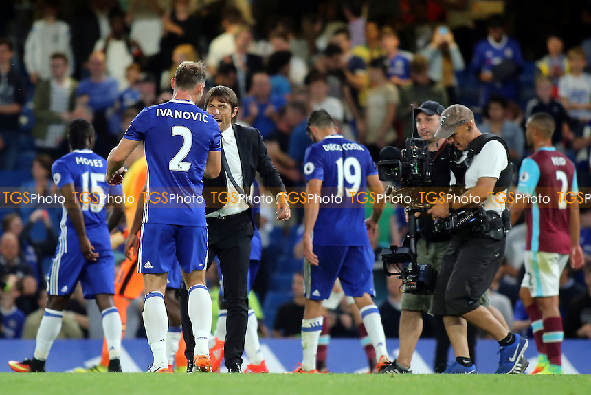 Chelsea Manager, Antonio Conte, shakes hands with Branislav Ivanovic at the final whistle during Chelsea vs West Ham United, Premier League Football at Stamford Bridge on 15th August 2016