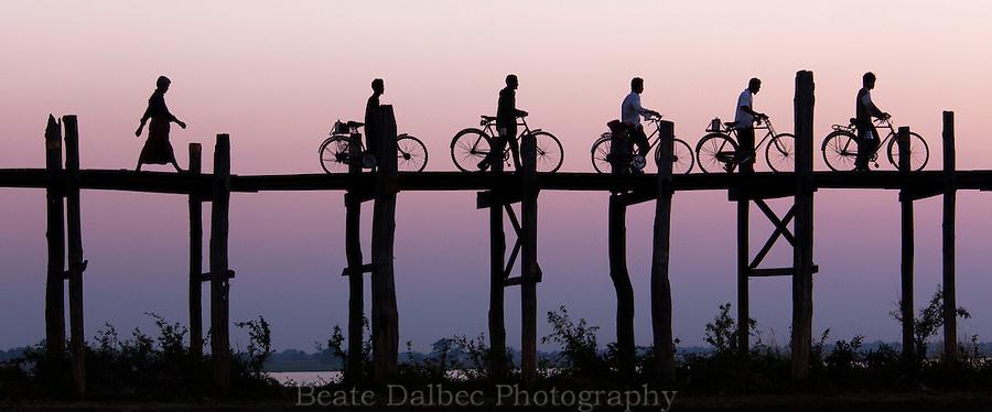 Bicycles on U Bein bridge at sunset, Amarapura, Myanmar