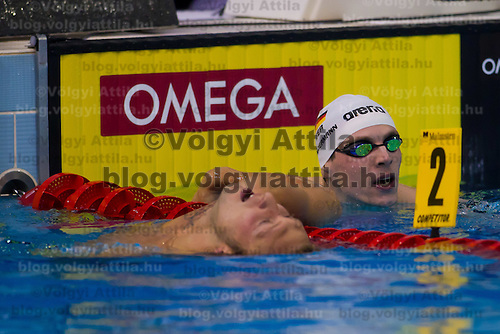 Paul Biedermann (R) of Germany and Amaury Leveaux (L) of France celebrate their victory in the Men's 200m Freestyle final of the 31th European Swimming Championships in Debrecen, Hungary on May 23, 2012. ATTILA VOLGYI