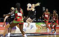 31.10.2013 Silver Fern Laura Langman in action during the Silver Ferns V Malawi during the New World Netball Series played at the Claudelands Arena in Hamilton. Mandatory Photo Credit ©Michael Bradley.