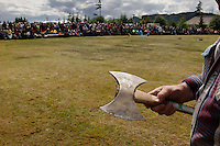 "The annual logging show held in Thorne Bay on Prince of Wales Island in the Tongass National Forest is the ""real thing"" --not a tourist show--where loggers, past loggers and wanna be loggers compete.  Men and women team up to cut through a hard spruce  log in a timed event called ""Jack and Jill."" They use the ""Misery whip,"" a two person bladed saw that takes muscles and skill to maneuver.There was a two person wheelbarrow race.  They also compete to empty a skiff full of water, toss hatchets at a target, throw chain saws, stack wood, and the big event is to climb a 65 foot pole.."