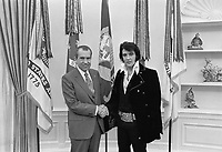 "Elvis Presley meeting Richard Nixon. On December 21, 1970, at his own request, Presley met then-President Richard Nixon in the Oval Office of The White House. Elvis is on the right. Waggishly, this picture is said to be 'of the two greatest recording artists of the 20th century'. The Nixon Library & Birthplace sells a number of souvenir items with this photo and the caption, ""The President & the King.""<br /> <br /> PHOTO : Ollie Atkins, chief White House photographer"