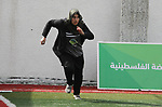 A Palestinian girl in action during the final women's softball game in Gaza city on February 7, 2018. Photo by Mahmoud Ajour
