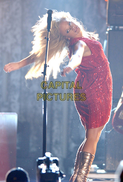 MIRANDA LAMBERT.2007 CMA Awards, Country Music's Biggest Night, held at the Sommet Center, Nashville, Tennessee, USA, .07 November 2007..live show on stage full length red dress silver boots head back funny.CAP/ADM/LF.©Laura Farr/AdMedia/Capital Pictures.