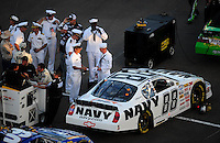 Apr 11, 2008; Avondale, AZ, USA; Navy sailors hang out near the car of NASCAR Nationwide Series driver Brad Keselowski prior to the Bashas Supermarkets 200 at the Phoenix International Raceway. Mandatory Credit: Mark J. Rebilas-