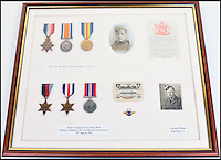 BNPS.co.uk (01202 558833)<br /> Pic: C&amp;TAuctions/BNPS<br /> <br /> The medals of father and son Albert and Norman Mayo.<br /> <br /> A poignant time capsule containing the last belongings of a tragic airman his grief-stricken parents couldn't bring themselves to look at has been discovered during a house clearance.<br /> <br /> The poignant archive of letters, logbooks, diary, photos and medals relating to Flight Sergeant Norman Mayo were placed in a small suitcase in 1945 by Albert and Annie Mayo and seemingly never opened again.<br /> <br /> The black leather case was found stashed under a bed by a house clearance firm tasked with getting rid of the contents before the empty property in Finchley, North London.<br /> <br /> The archive is now being sold by C&amp;T Auctioneers.
