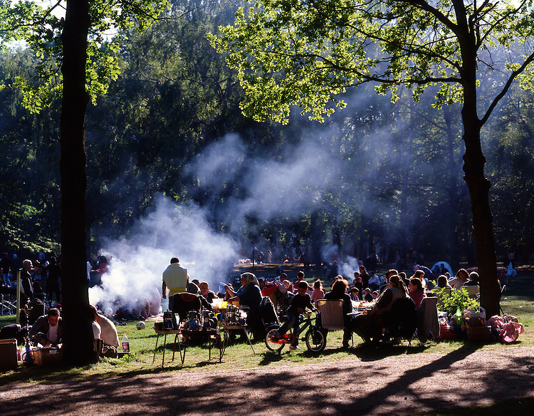People are grilling in the park Tiergarten in the weekend.