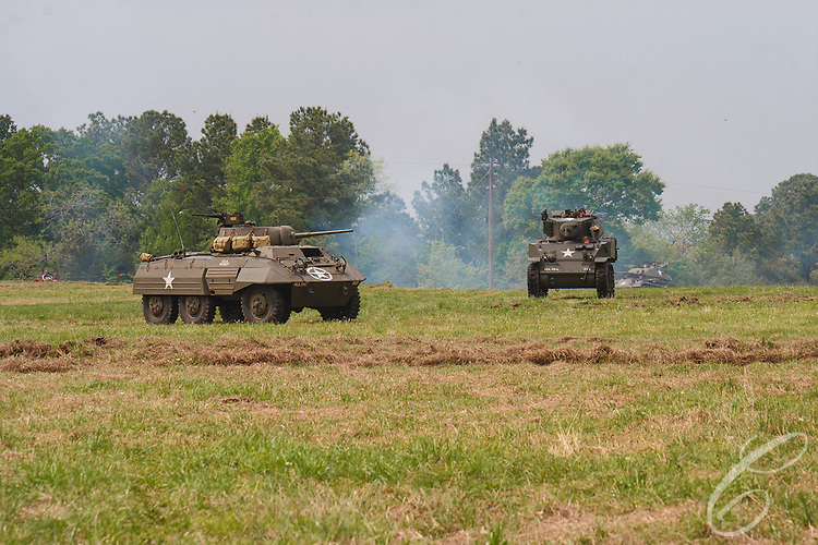 "Reenactors showcase World War II tanks, half-tracks and support vehicles during the Museum of the America G.I.'s annual Open House on March 29, 2008 in College Station, Texas.   At left is a  M8 ""Greyhound""  armored car and a M5 Stuart is at right."