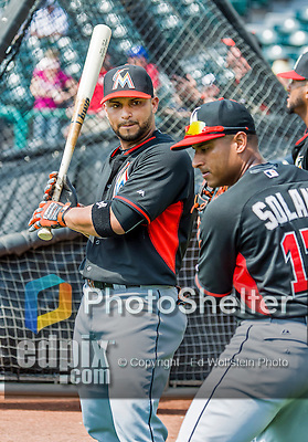 19 March 2015: Miami Marlins catcher Jhonatan Solano awaits his turn in the batting cage with his brother Donovan Solano showing him a stance prior to a Spring Training game against the Atlanta Braves at Champion Stadium in the ESPN Wide World of Sports Complex in Kissimmee, Florida. The Braves defeated the Marlins 6-3 in Grapefruit League play. Mandatory Credit: Ed Wolfstein Photo *** RAW (NEF) Image File Available ***