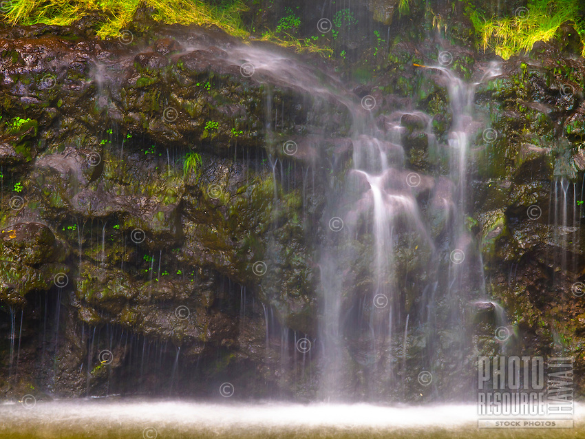 An intimate view at the bottom of the 400-ft. Waimoku Falls, at the end of one of the bamboo forests of the Pipiwai Trail, Haleakala National Park, Maui.