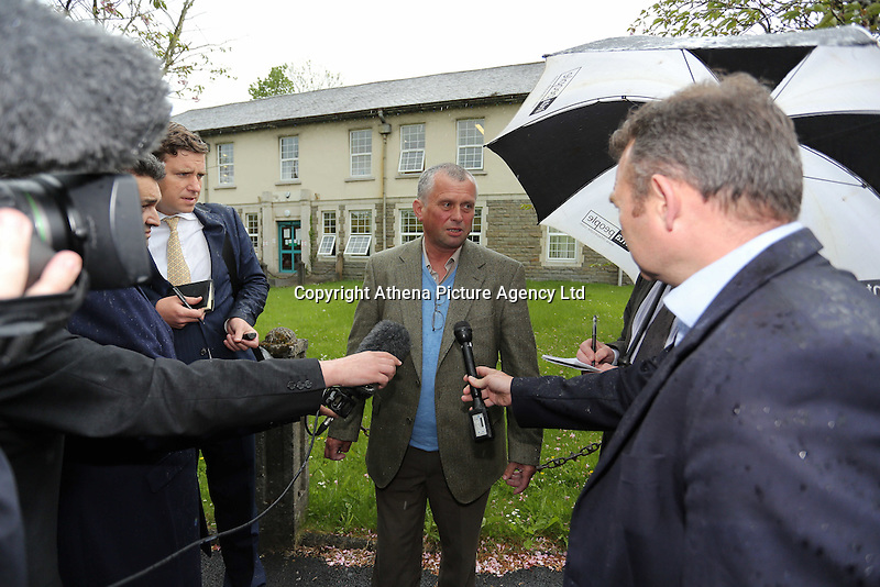 """COPY BY TOM BEDFORD<br />Pictured: Christopher Sabine (C), the son of John Sabine from a previous marriage, outside the Aberdare Coroner's Court after the verdict Thursday 19 May 2016<br />Re: A man found wrapped in plastic in his Rhondda Cynon Taff garden was unlawfully killed, a coroner has concluded.<br />The body of John Henry Sabine was found at the rear of flats at Trem-y-Cwm, Beddau, on 24 November. The cause of death was blunt force head trauma.<br />Mr Sabine's wife Leigh Ann, who died last October, is the main suspect.<br />His inquest in Aberdare was told she admitted killing her husband with a stone frog in a phone call to a friend.<br />South Wales Central Coroner Andrew Barkley said it was """"beyond doubt in my mind that foul play was the cause of his death"""".<br />He said the cause was blunt force injury to the head, with the evidence about the stone frog fitting with this.<br />The coroner said there was no recorded history of domestic violence or that Mrs Sabine acted in self defence and he was satisfied her husband was unlawfully killed."""