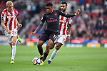 Alex Iwobi of Arsenal is challenged by Eric Maxim Choupo Moting of Stoke City and Darren Fletcher of Stoke City during the premier league match at the Britannia Stadium, Stoke. Picture date 19th August 2017. Picture credit should read: Robin Parker/Sportimage