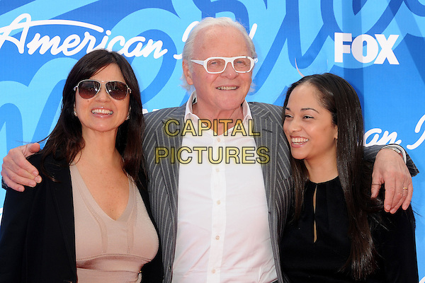 Stella Arroyave, Sir Anthony Hopkins & guest.American Idol 2013 Finale - Arrivals held at the Nokia Theatre LA Live, Los Angeles, California, USA..May 16th, 2013.half arms over shoulders length dress sunglasses shades beige top married husband wife dress shirt grey gray pinstripe jacket suit glasses frames white  .CAP/ADM/BP.©Byron Purvis/AdMedia/Capital Pictures
