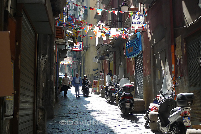 The Spanish Quarter of Naples takes its name from the Spanish troops who laid out a neighborhood grid of narrow streets after taking control of the city beginning in 1504. Don Pedro de Toledo first laid out the Quarter as troop housing and its main thoroughfare is still known as Via Toledo. The quarter consists of dozens of symmetrical square blocks, with streets running east-west up the slope of San Martino.