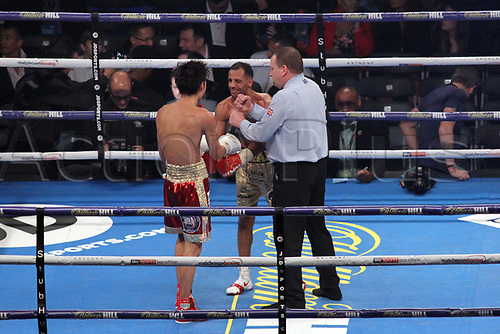 28th October 2017, Principality Stadium, Cardiff, Wales; World Heavyweight Boxing, Anthony Joshua versus Carlos Takam, Undercard fight;  Kal Yafai Versus Sho Ishida for WBA super flyweight world championship; Referee Howard Foster brings Kal Yafai and Sho Ishida to the middle of the ring to touch gloves before the start of the final round