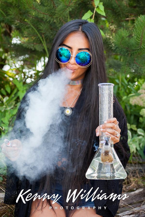 Daisy Smoking Marijuana with Glass Bong, Seattle Hempfest, WA, USA.