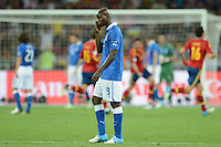 01.07.2012 Kiev, Ukraine.  Italy's MarioBalotelli reacts after Spain's Silva (not pictured) scored the opening goal for Spain during the UEFA EURO 2012 final soccer match Spain vs. Italy at the Olympic Stadium in Kiev, Ukraine, 01 July 2012.