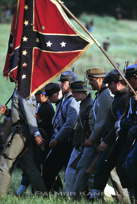 Confederate soldiers march with flag in Civil War reenactment at Gettysburg on July 4th