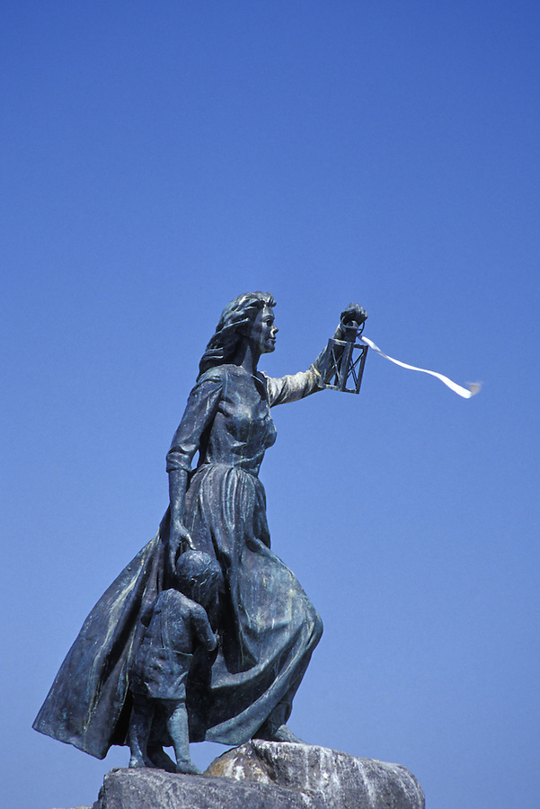 Statue of woman holding lantern, ribbon, and young boy, Anacortes, Fidalgo Island, Washington