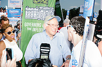 Supporters and the media surround Democratic presidential candidate and Vermont senator Bernie Sanders before he marches in the Labor Day parade in Milford, New Hampshire.