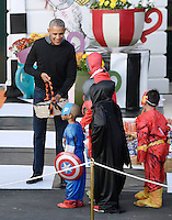 United States President Barack Obama  hands out treats during a Halloween event at the South Lawn of the White House October 31, 2016 in Washington, DC. The first couple hosted local children and children of military families for trick-or-treating at the White House.<br /> Credit: Olivier Douliery / Pool via CNP /MediaPunch
