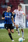 FC Internazionale Defender Joao Miranda (L) plays against Bayern Munich Forward Thomas Muller (R) during the International Champions Cup match between FC Bayern and FC Internazionale at National Stadium on July 27, 2017 in Singapore. Photo by Marcio Rodrigo Machado / Power Sport Images