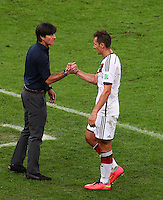 Germany coach Joachim Low shakes hands with Miroslav Klose of Germany after being substituted in what could be his final World Cup appearance