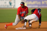 Harold Garcia #34 of the Lakewood BlueClaws can't handle the throw as Justin Greene #11 of the Kannapolis Intimidators slides into second base with a double at Fieldcrest Cannon Stadium July 10, 2009 in Kannapolis, North Carolina. (Photo by Brian Westerholt / Four Seam Images)