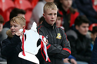 A young Doncaster fan with a silver foil FA Cup before Doncaster Rovers vs Crystal Palace, Emirates FA Cup Football at the Keepmoat Stadium on 17th February 2019
