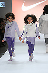 Model walks runway in an outfit from the NIKE Fall 2017 children's collection, during the Rookie USA Fall 2017 kidswear fashion show, presented by Haddad Brands at NYFW: The Shows Fall 2017 at Skylight Clarkson Square on February 15, 2017.