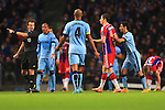 Jesus Navas of Manchester City gives Robert Lewandowski of Munich a push as he is slow to make his way off following substitution - Manchester City vs. Bayern Munich - UEFA Champion's League - Etihad Stadium - Manchester - 25/11/2014 Pic Philip Oldham/Sportimage