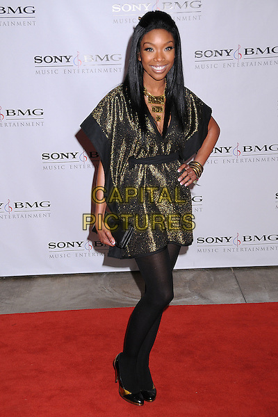 BRANDY NORWOOD.The 2008 Sony BMG Post Grammy Party held at The Beverly Hills Hotel in Beverly Hills, California, USA..February 10th, 2008 .full length gold metallic dress hand on hip green black tights .CAP/ADM/BP.©Byron Purvis/AdMedia/Capital Pictures.