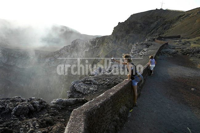 A tourist takes pictures of the Santiago volcano at Masaya national park.