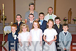 Sean Sheahan, Shauna Sheahan, Rachel Sheahan, Juliette Sheahan, Gearo?id Griffin, Craig Dalton, Dara Casey, Sean Coffey and Patrick Griffin, Glenbeigh national school, pictured with teacher Mary Jo Curran and Fr Anthony O'Sullivan, after they made their first holy communion in St James' church, Glenbeigh on Saturday.............