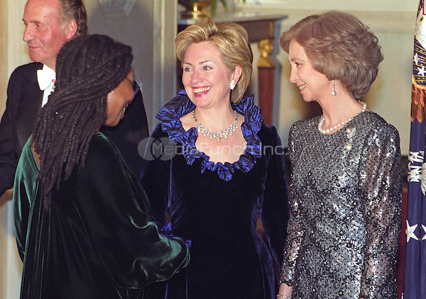 Actress Whoopi Goldberg, left, is greeted by First Lady Hillary Rodham Clinton, center, as she passes through the receiving line in the Grand Foyer of the White House prior to the State Dinner honoring the Queen and King Juan Carlos I of Spain on February 23, 2000 in Washington, D.C.  Queen Sofia of Spain, right, looks on. <br /> Credit: Ron Sachs / CNP/MediaPunch