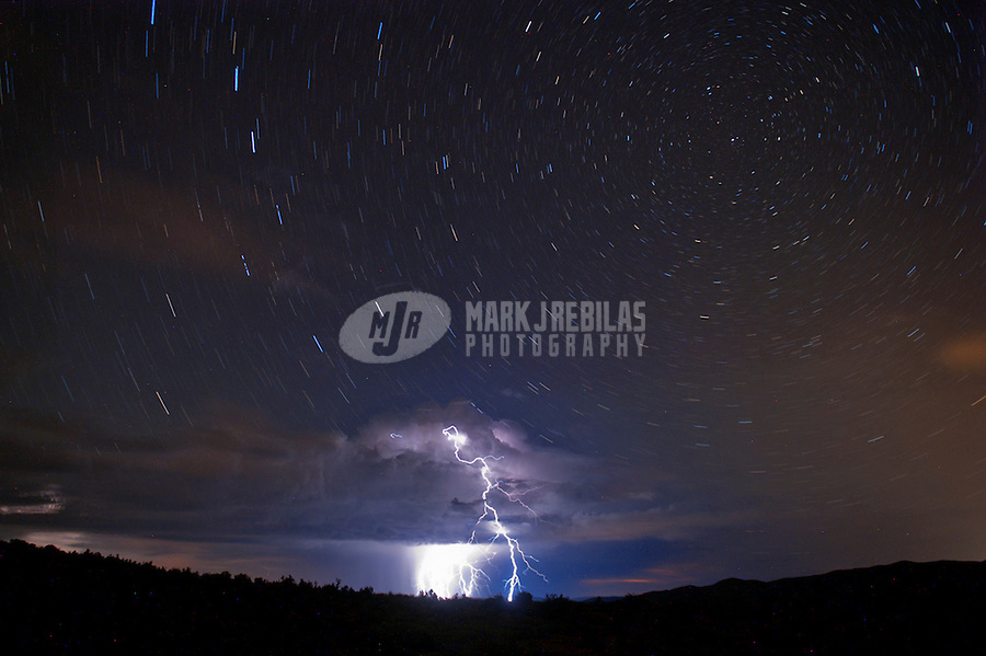 Lightning strike bolt thunderstorm monsoon storm thunderstorm Arizona desert sky mountain stars night chaser chasing startrails trail star long exposure photography spinning rotating