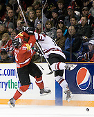 Dominik Schlumpf (Switzerland - 18), Ronalds Kenins (Latvia - 15) - Team Switzerland defeated Team Latvia 7-5 on Wednesday, December 30, 2009, at the Credit Union Centre in Saskatoon, Saskatchewan, during the 2010 World Juniors tournament.
