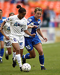 Sharolta Nonen (6) tries to keep the ball away from Abby Wambach (28) at RFK Stadium in Washington, DC on 4/26/03 during a game between the Atlanta Beat and Washington Freedom