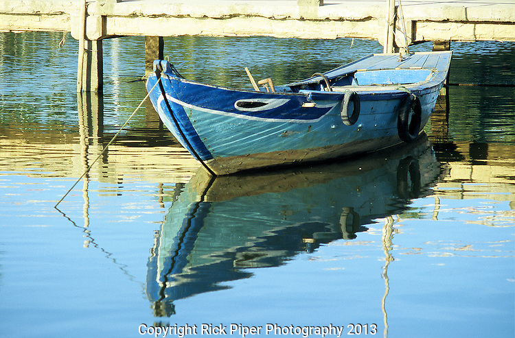 Boat 01 - Small blue rowing boat reflected in the Thu Bon river, Hoi An, Viet Nam