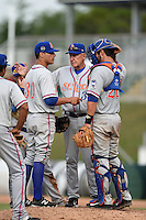 St. Lucie Mets pitching coach Phil Regan (33) talks with pitcher Robert Coles (30) and catcher Colton Plaia (26) during a game against the Fort Myers Miracle on April 19, 2015 at Hammond Stadium in Fort Myers, Florida.  Fort Myers defeated St. Lucie 3-2 in eleven innings.  (Mike Janes/Four Seam Images)