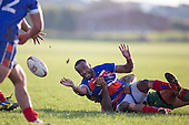 Lolohea Loco passes the ball as he goes to ground in the tackle. Counties Manukau Premier Club Rugby game between Waiuku and Ardmore Marist, played at Waiuku on Saturday June 4th 2016. Ardmore Marist won 46 - 3 after leading 39 - 3 at Halftime. Photo by Richard Spranger.