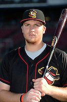 Quad Cities River Bandits first baseman A.J. Reed (18) poses for a photo before a game against the Cedar Rapids Kernels on August 18, 2014 at Perfect Game Field at Veterans Memorial Stadium in Cedar Rapids, Iowa.  Cedar Rapids defeated Quad Cities 5-3.  (Mike Janes/Four Seam Images)