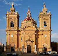 View from the front of the Church of Our Lady of Victories, 1743, Xaghra, Gozo, Malta, pictured on June 1, 2008, in the afternoon. The Republic of Malta consists of seven islands in the Mediterranean Sea of which Malta, Gozo and Comino have been inhabited since c.5,200 BC. It has been ruled by Phoenicians (Malat is Punic for safe haven), Greeks, Romans, Fatimids, Sicilians, Knights of St John, French and the British, from whom it became independent in 1964. Nine of Malta's important historical monuments are UNESCO World Heritage Sites. Gozo is the second largest Island. The Church of Our Lady of Victories, or Maria Bambina, was destroyed in World War II and later restored. Picture by Manuel Cohen.