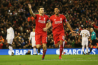 Liverpool's James Milner celebrates scoring from the penalty spot during the Barclays Premier League match between Liverpool and Swansea City played at The Anfield Stadium on November 29th 2015
