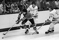 California Golden Seals Ralph Klassen and Gary Holt chasing Chicago Blackhawks Dale Tallon..(1976 photo by Ron Riesterer)