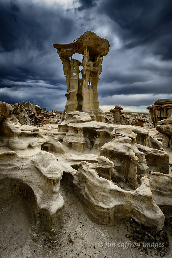 A hoodoo with it's support column eroded clear through in places stands in a remote section of Ah Shi Sle Pah Wash in New Mexico's San Juan Basin.