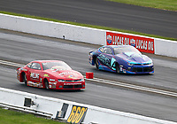 Sep 1, 2018; Clermont, IN, USA; NHRA pro stock driver Erica Enders (near) races alongside Shane Tucker during qualifying for the US Nationals at Lucas Oil Raceway. Mandatory Credit: Mark J. Rebilas-USA TODAY Sports