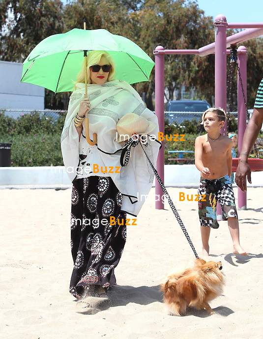 Gwen Stefani with her sons Kingston  and Zuma Rossdale enjoying the day in Malibu beach..Los Angeles, May 18, 2013..
