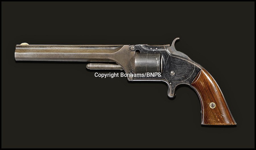 BNPS.co.uk (01202) 558833<br /> Picture: Bonhams<br /> <br /> A pistol belonging to famed American Old West gunslinger 'Wild' Bill Hickok has emerged 150 years after he was murdered. Hickok, a lawman known as the best shot in the West, was playing poker with pals at a saloon in Deadwood, South Dakota, when he was shot in the back of the head by 'Crooked Nose' Jack McCall, in 1876. He was holding two black aces, two black eights and another unknown card, which went on to become known as the 'dead man's hand'. The gun boasts a .32 rimfire, a six-inch barrel, blued finish and varnished rosewood grips. Buyers will need a fistful of dollars if they want to get their hands on the legendary shooter - as it comes with a whopping £320,000 price tag.
