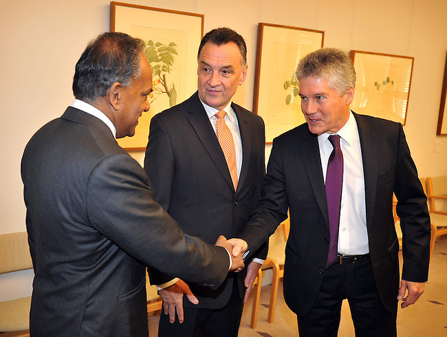 Singapore Foreign Minister Shanmugam meets Australian Trade Minister  Emerson, centre, and Australian Defence Minister Smith at Parliament House Canberra, Monday September 10th 2012. AFP PHOTO / Mark GRAHAM